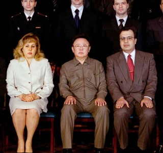 North Korean leader Kim Jong-il and Russian embassy officials pose in Pyongyang