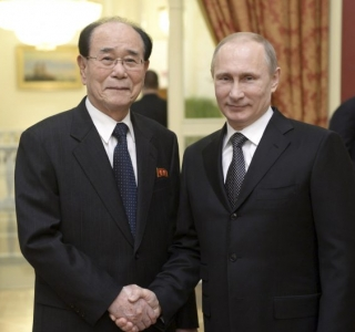 KCNA photo of North Korean delegation committee leader Kim Young Nam, an honorary guest at the opening ceremony for the 2014 Sochi Winter Olympic Games, meeting with Russian President Vladimir Putin in Sochi