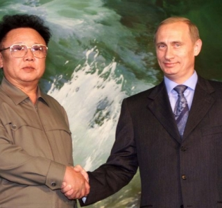FILE PHOTOGRAPH OF NORTH KOREAN LEADER KIM JONG-IL SHAKING HANDS WITH RUSSIAN PRESIDENT PUTIN IN PYONGYANG