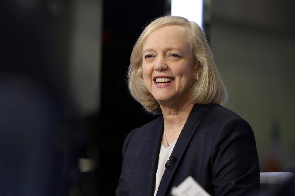 FILE - In this Nov. 2, 2015 file photo, Hewlett Packard Enterprise President and CEO Meg Whitman is interviewed on the floor of the New York Stock Exchange. Top Republican donor and fundraiser Whitman is endorsing Democrat Hillary Clinton for president, saying she cannot support a candidate who has