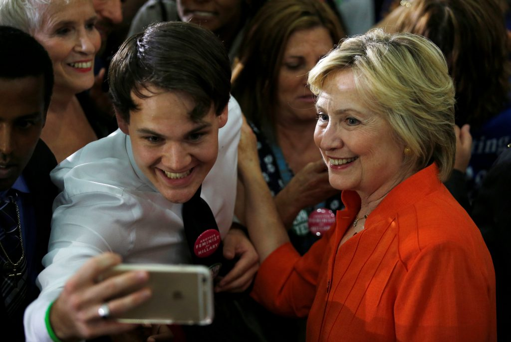 U.S. Democratic presidential nominee Hillary Clinton takes a selfie with a supporter during a campaign rally in Saint Petersburg, Florida, August 8, 2016. REUTERS/Chris Keane