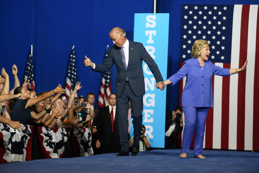 Vice President Joe Biden, left, and Democratic presidential candidate Hillary Clinton react to the crowd during a campaign event Monday, Aug. 15, 2016, in Scranton, Pa. (Butch Comegys/The Times & Tribune via AP)