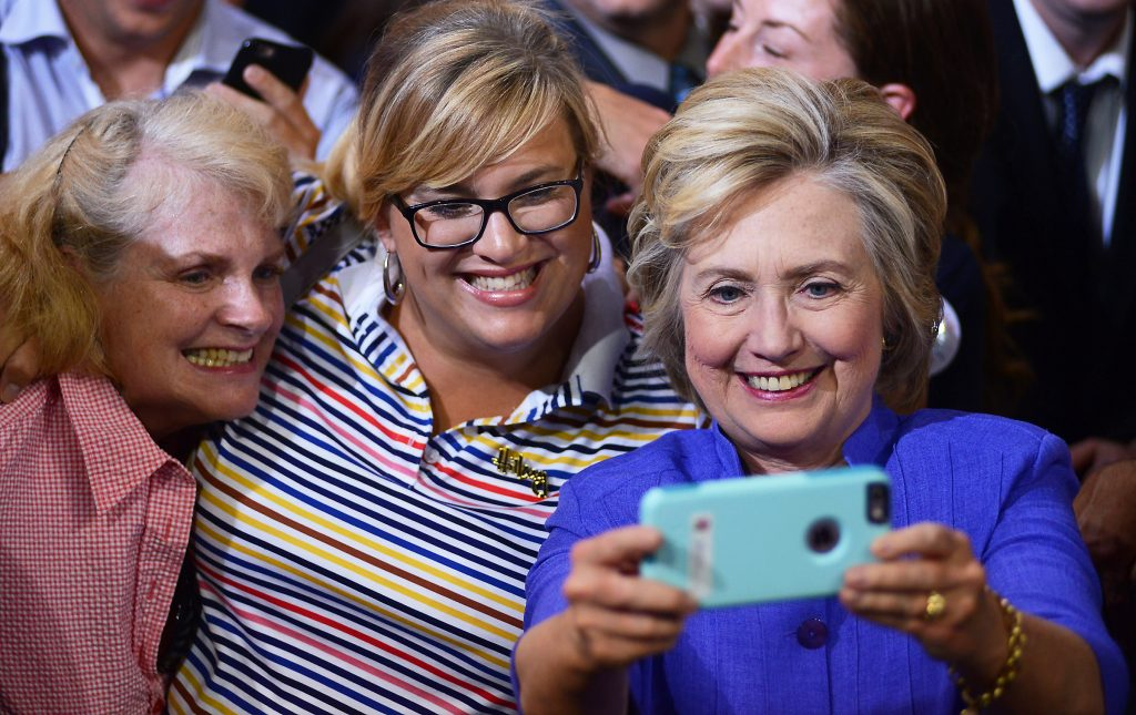 Democratic presidential candidate Hillary Clinton, right, takes a photo with a cell phone while posing with supporters during a campaign event Monday, Aug. 15, 2016, in Scranton, Pa. (Butch Comegys/The Times & Tribune via AP)