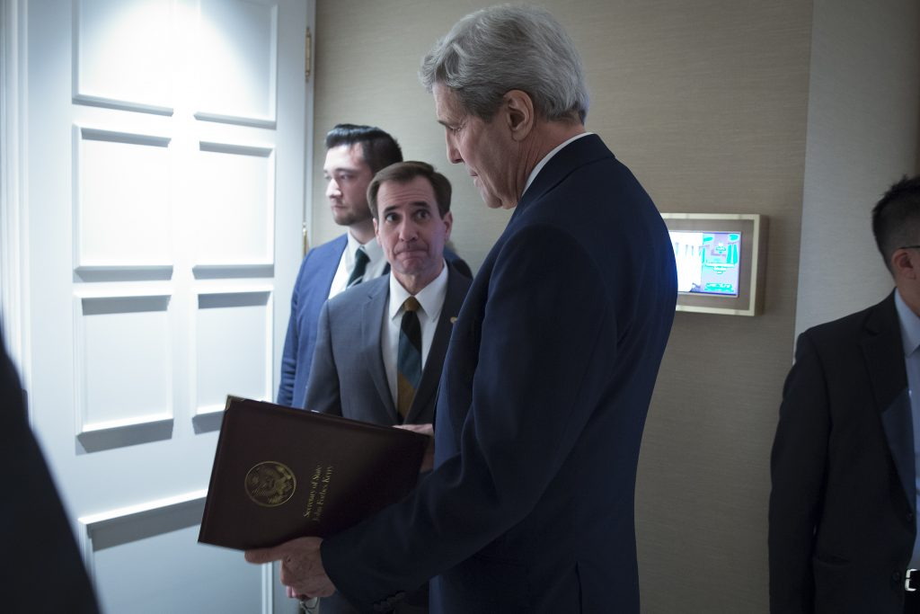 FILE - In this Oct. 23, 2015 file-pool photo, Secretary of State John Kerry, speaks to senior adviser John Kirby before a news conference in Vienna. The State Department says a $400 million cash payment to Iran was contingent on the release of American prisoners. Spokesman Kirby says negotiations over the U.S. returning Iranian money from a decades-old account was conducted separately from the prisoner talks. But he says the U.S. withheld delivery of the cash as leverage until the U.S. citizens had left Iran. (Carlo Allegri/Pool Photo via AP, File)