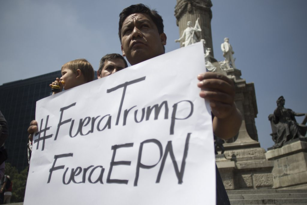 People demonstrate against the inminent visit of US presidential candidate Donald Trump to Mexico, in Mexico City on August 31, 2016. Donald Trump was expected in Mexico Wednesday to meet its president, in a move aimed at showing that despite the Republican White House hopeful's hardline opposition to illegal immigration he is no close-minded xenophobe. Trump stunned the political establishment when he announced late Tuesday that he was making the surprise trip south of the border to meet with President Enrique Pena Nieto, a sharp Trump critic. / AFP PHOTO / Alejandro AYALA