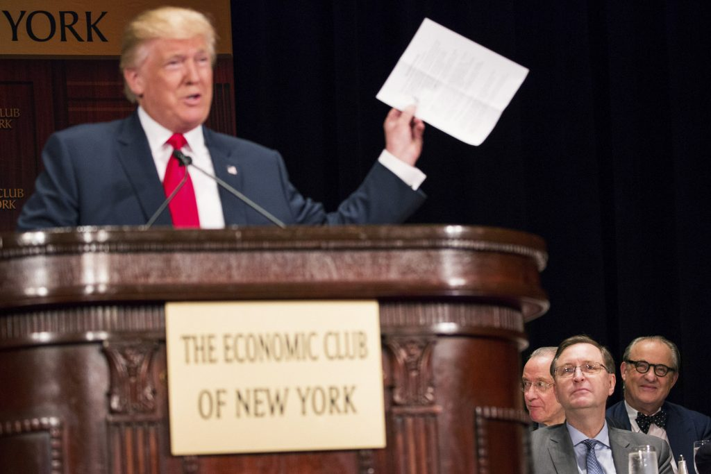 Attendees listen as Donald Trump, the Republican presidential nominee, speaks about economic policy at a luncheon for the Economic Club of New York at the Waldorf Astoria Hotel in New York, Sept. 15, 2016. (Damon Winter/The New York Times)