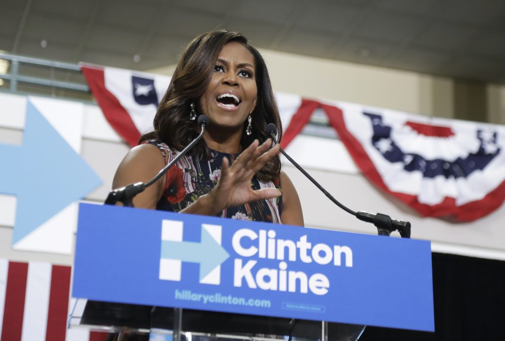 First lady Michelle Obama speaks during a campaign rally in support of Democratic presidential candidate Hillary Clinton and vice presidential candidate Tim Kaine, D-Va., Friday, Sept. 16, 2016, at George Mason University in Fairfax, Va. (AP Photo/Manuel Balce Ceneta)
