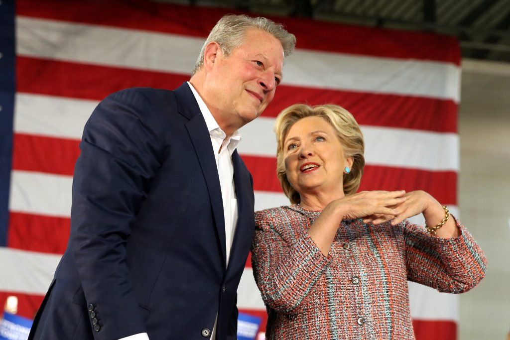 U.S. Democratic presidential nominee Hillary Clinton (R) and former Vice President Al Gore talk about climate change at a rally at Miami Dade College in Miami, Florida, U.S. October 11, 2016. REUTERS/Lucy Nicholson
