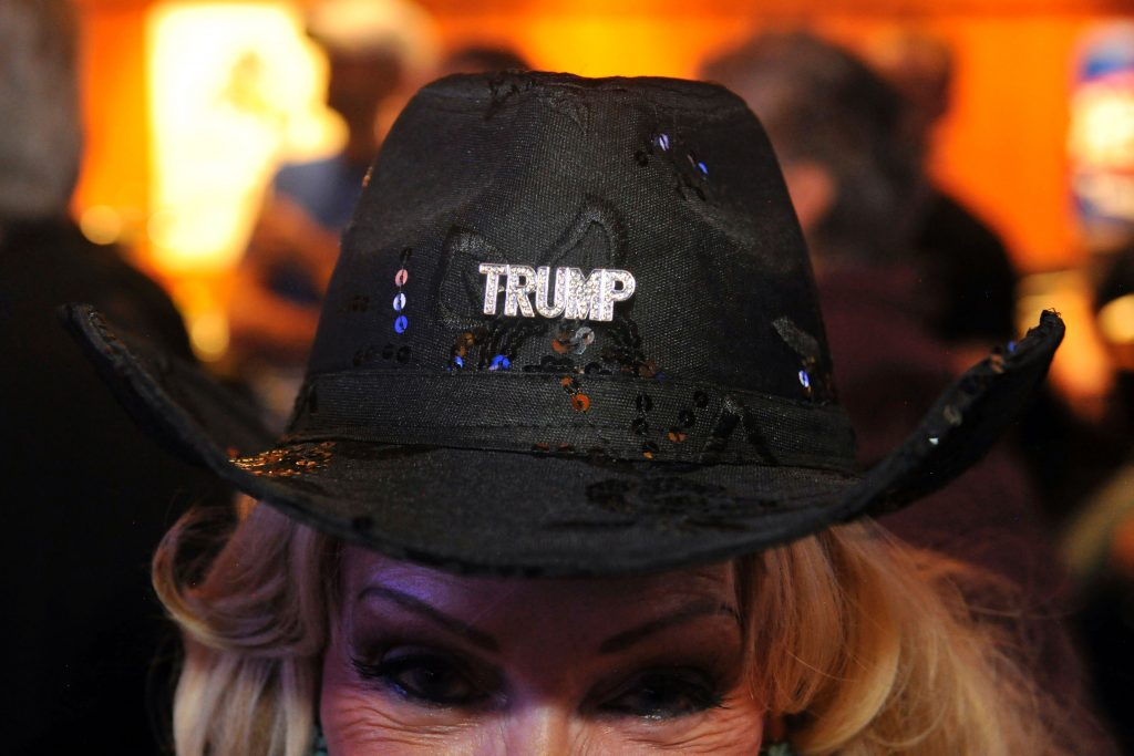 A supporter of Republican presidential nominee Donald Trump wears a cowboy hat with a Trump sequin as she watches the second US presidential debate between Republican presidential nominee Donald Trump and Democratic presidential nominee Hillary Clinton during a debate watch party at Choppers Sports Grill in Denver, Colorado, on, October 9, 2016. / AFP PHOTO / Jason Connolly
