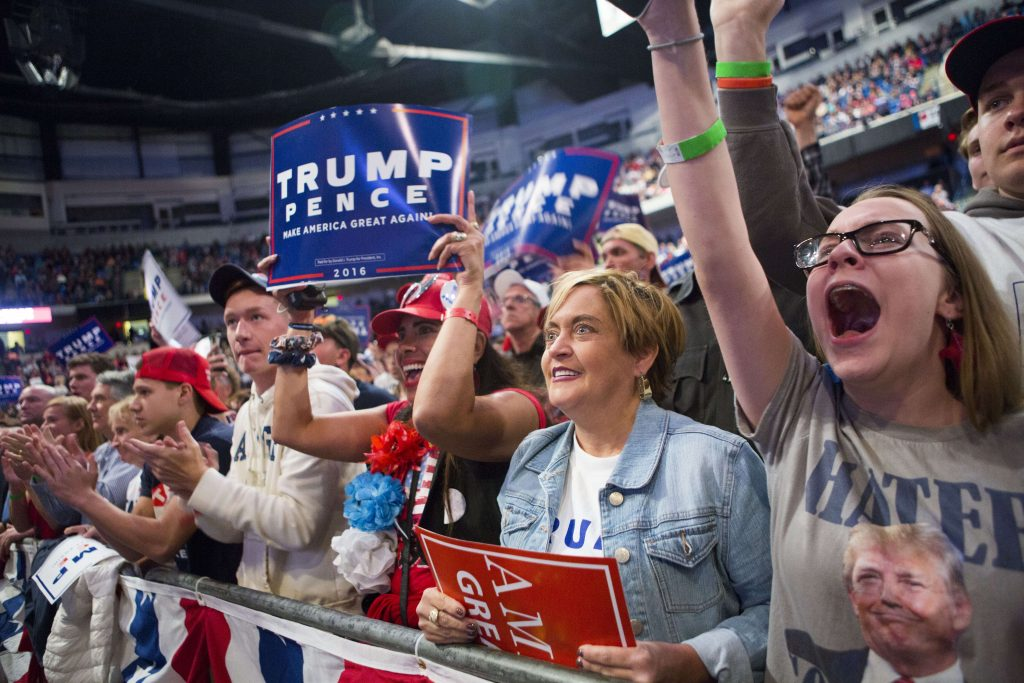 WILKES-BARRE, PA - OCTOBER 10: Supporters cheer at a campaign rally for Republican presidential nominee Donald Trump on October 10, 2016 in Wilkes-Barre, Pennsylvania. Trump continues his campaign following a town hall style debate against the Democratic nominee Hillary Clinton at Washington University in St. Louis last night. Jessica Kourkounis/Getty Images/AFP == FOR NEWSPAPERS, INTERNET, TELCOS & TELEVISION USE ONLY ==