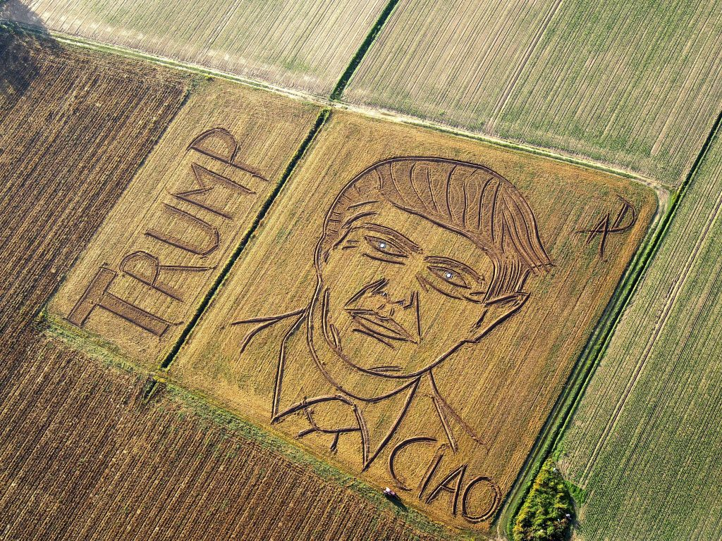 In this photo taken on Tuesday, Oct. 25, 2016, an aerial view of a giant portrait of U.S. Republican Presidential nominee Donald Trump. Italian land artist Dario Gambarin has used his tractor to transform a field near the Italian city of Verona into a giant portrait of Donald Trump. This artist created a similar portrait for Democratic nominee Hillary Clinton in September. Gambarin created the portrait on a 25,000-square-meter field, writing ''Ciao,'' beneath Trump's left shoulder, signifying recent polls that show Clinton leading the race. (Dario Gambarin via AP)