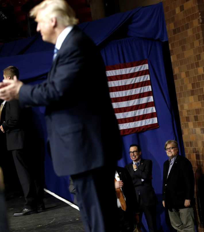 Stephen Bannon (R) looks on as Republican presidential nominee Donald Trump appears at a campaign rally in Canton, Ohio, U.S. on September 14, 2016.  REUTERS/Mike Segar/File Photo