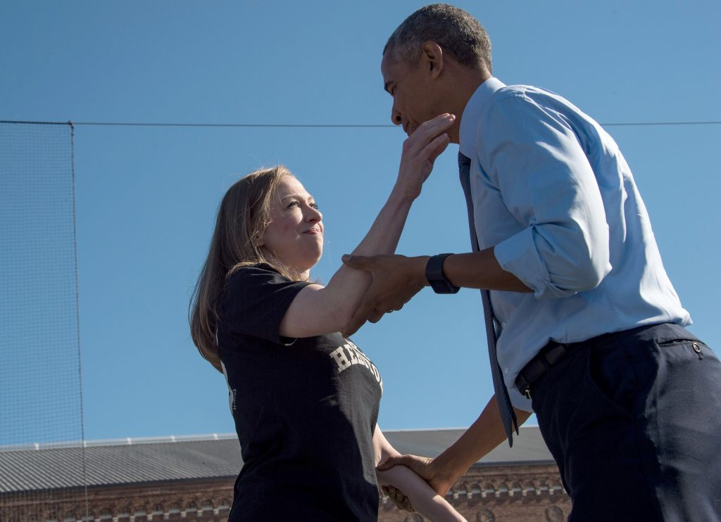 US President Barack Obama greets Chelsea Clinton after she introduced him at a rally for her mother Democratic presidential nomnee Hillary Clinton in Ann Arbor, Michigan, on November 7, 2016. / AFP PHOTO / NICHOLAS KAMM