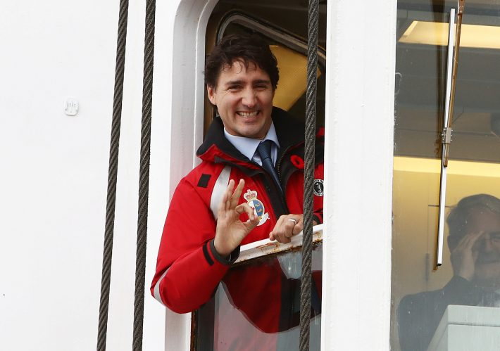 Canada's Prime Minister Justin Trudeau looks out a cabin window while touring the CCGS Wilfrid Laurier during a boat tour of Burrard Inlet near Vancouver, B.C., Canada November 7, 2016. REUTERS/Ben Nelms