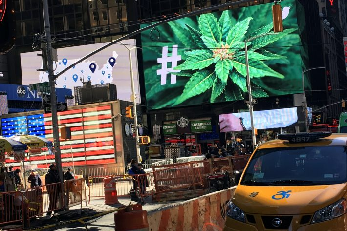An electronic billboard displays a marijuana hashtag at Times Square in New York, U.S., November 7, 2016. REUTERS/Shannon Stapleton
