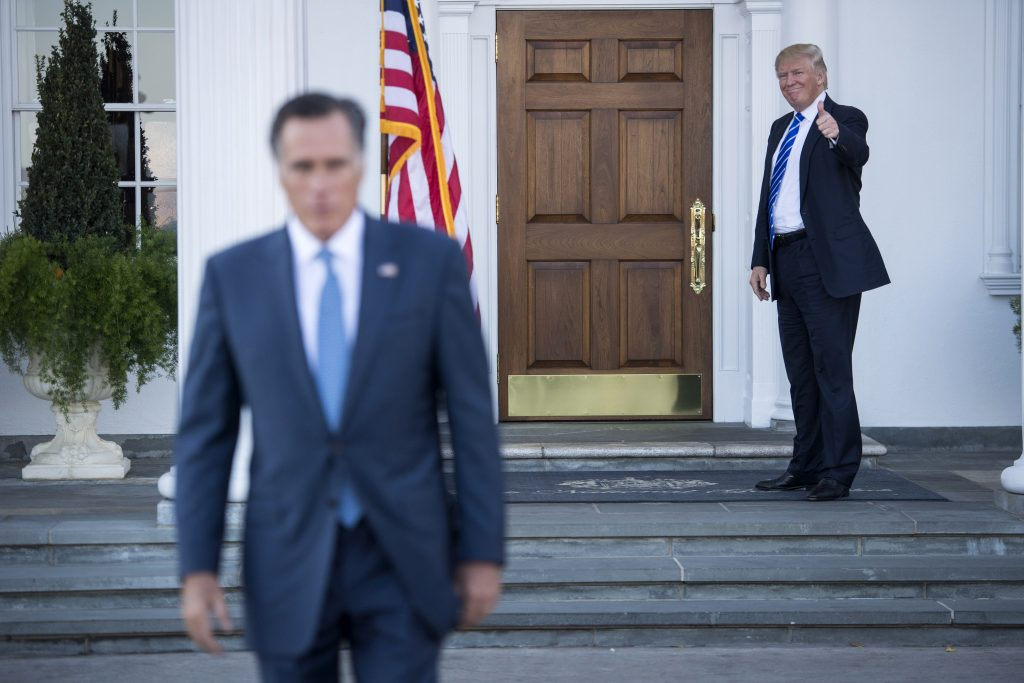 Donald Trump gives a thumbs up as Mitt Romney walks out of a meeting at the Trump golf club in Bedminster Township, N.J. on Nov. 19. MUST CREDIT: Washington Post photo by Jabin Botsford