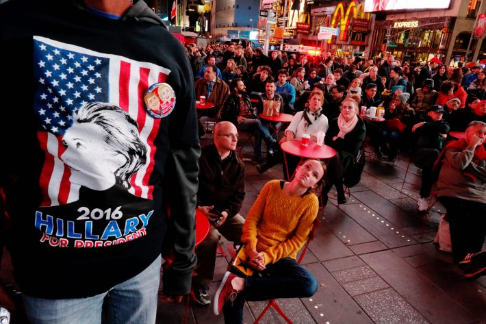 People gather around Times Square to watch televised results of the US presidential election on November 8, 2016 in New York. Millions of Americans voted November 8th for their new leader in a historic election that will either elevate Democrat Hillary Clinton as their first woman president or hand power to maverick populist Donald Trump. / AFP PHOTO / EDUARDO MUNOZ ALVAREZ