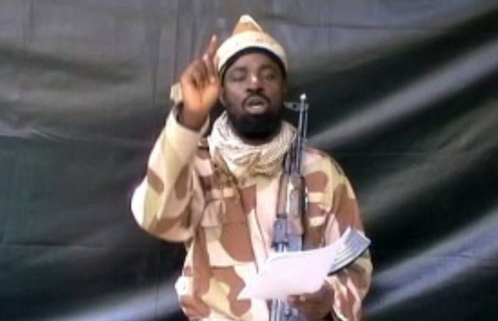 A grab made on July 13, 2013 from a video obtained by AFP shows the leader of the Islamist extremist group Boko Haram Abubakar Shekau, dressed in camouflage and holding an Kalashnikov AK-47. The head of Nigeria's Boko Haram Islamists said in a video obtained by AFP on July 13, 2013 he supported a July 6 attack on a school that killed 42 people, but did not claim responsibility for the massacre.