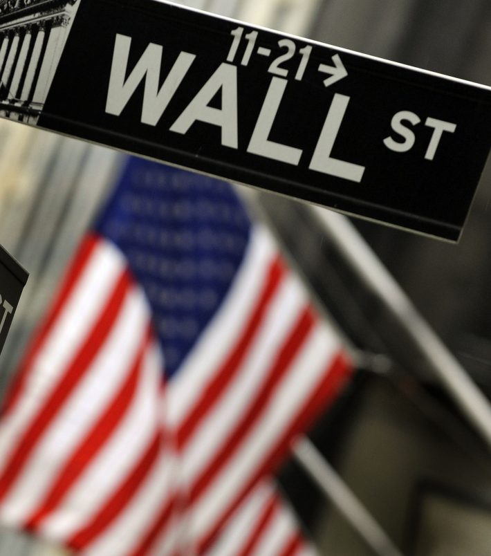 (FILES) This file photo taken on October 15, 2009 shows a sign for Wall Street in New York. US stocks jumped 1.3 percent in opening trading November 7, 2016, joining a global rally after the FBI lifted the threat that Democratic candidate Hillary Clinton could face charges over her emails.The early gains snapped a nine-day losing streak for the S&P 500 as controversial Republican candidate Donald Trump has gained ground on Clinton, the preferred choice of markets. / AFP PHOTO / TIMOTHY A. CLARY