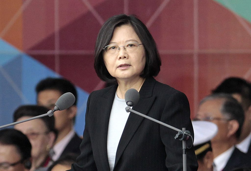 "FILE - In this Oct. 10, 2016, file photo, Taiwan's President Tsai Ing-wen delivers a speech during National Day celebrations in front of the Presidential Building in Taipei, Taiwan. President-elect Donald Trump spoke Dec. 2, with the president of Taiwan, a self-governing island the U.S. broke diplomatic ties with in 1979. It is highly unusual, perhaps unprecedented, for a U.S. president or president-elect to speak directly with a Taiwanese leader and will be sure to anger China. Washington has pursued a so-called ""one China"" policy since 1979 when it shifted diplomatic recognition of China from the government in Taiwan to the communist government on the mainland. (AP Photo/Chiang Ying-ying, File)"
