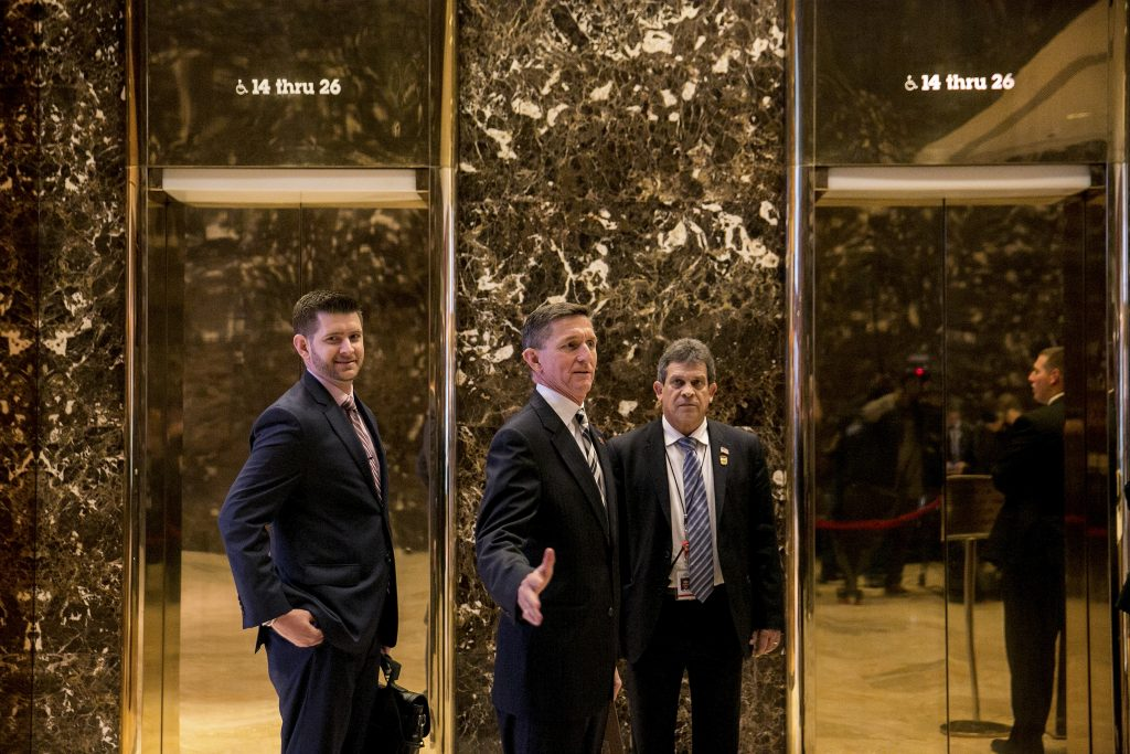 FILE — Retired Lt. Gen. Michael T. Flynn — Donald Trump's choice for national security adviser — and his son, Michael G. Flynn, left, arrive at Trump Tower in New York, Nov. 17, 2016. After earlier denials that the younger Flynn had ever had any role in the transition process, Trump fired him on Dec. 6 for using social media to spread a fake news story about Hillary Clinton. (Sam Hodgson/The New York Times)