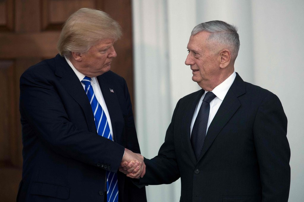(FILES) This file photo taken on November 19, 2016 shows US President-elect Donald Trump shaking hands with retired United States Marine Corps General James Mattis after their meeting at Trump International Golf Club, in Bedminster, New Jersey. Trump has reportedly selected retired Mattis as his secretary of defense, according to US media citing a source close to the transition team. / AFP PHOTO / GETTY IMAGES NORTH AMERICA / Drew Angerer