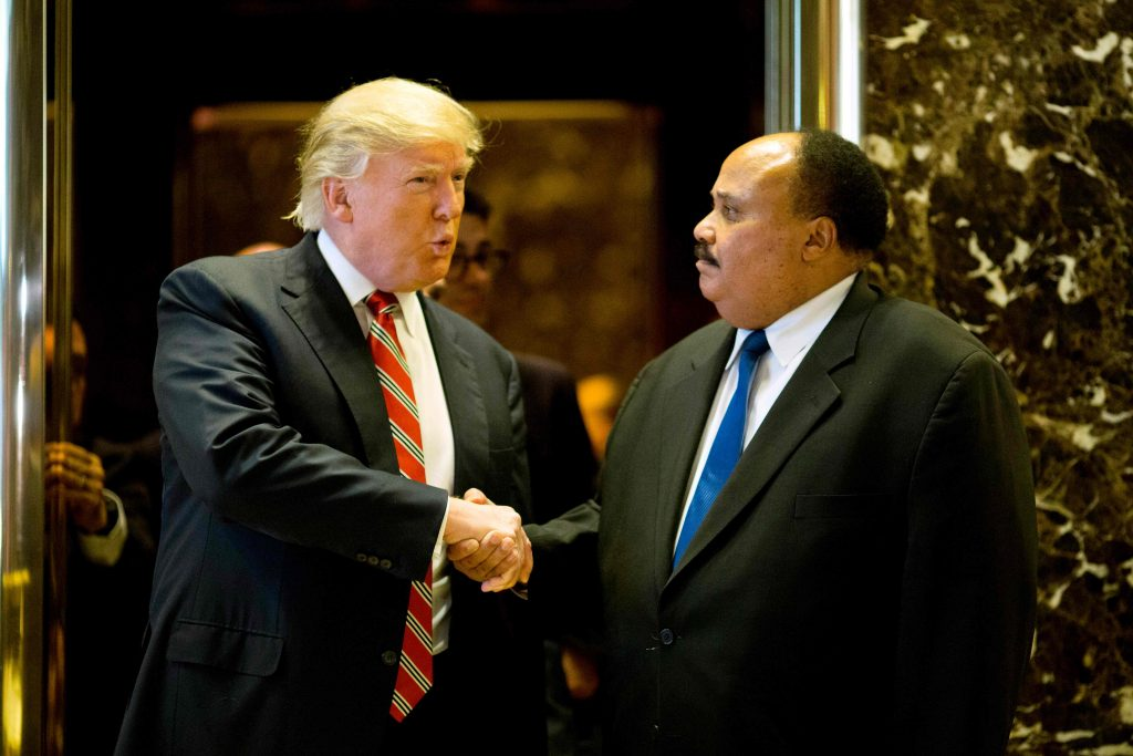 US President-elect Donald Trump shakes hands with Martin Luther King III after meeting at Trump Tower in New York City on January 16, 2017.  The eldest son of American civil rights icon Martin Luther King Jr. met with US President-elect on the national holiday observed in remembrance of his late father. / AFP PHOTO / DOMINICK REUTER