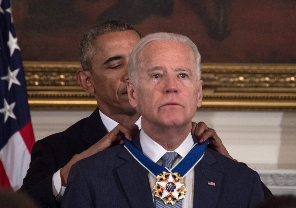 US President Barack Obama awards Vice President Joe Biden the Presidential Medal of Freedom during a tribute to Biden at the White House in Washington, DC, on January 12, 2017. / AFP PHOTO / NICHOLAS KAMM