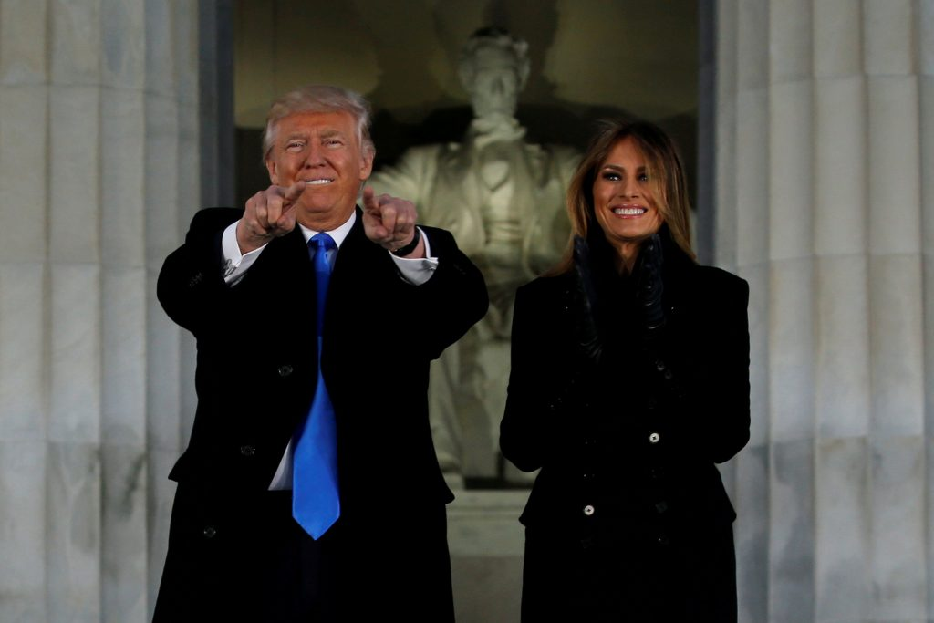 FILE PHOTO: U.S. President-elect Donald Trump and his wife Melania take part in a Make America Great Again welcome concert at the Lincoln Memorial in Washington, U.S. January 19, 2017. REUTERS/Jonathan Ernst/File Photo