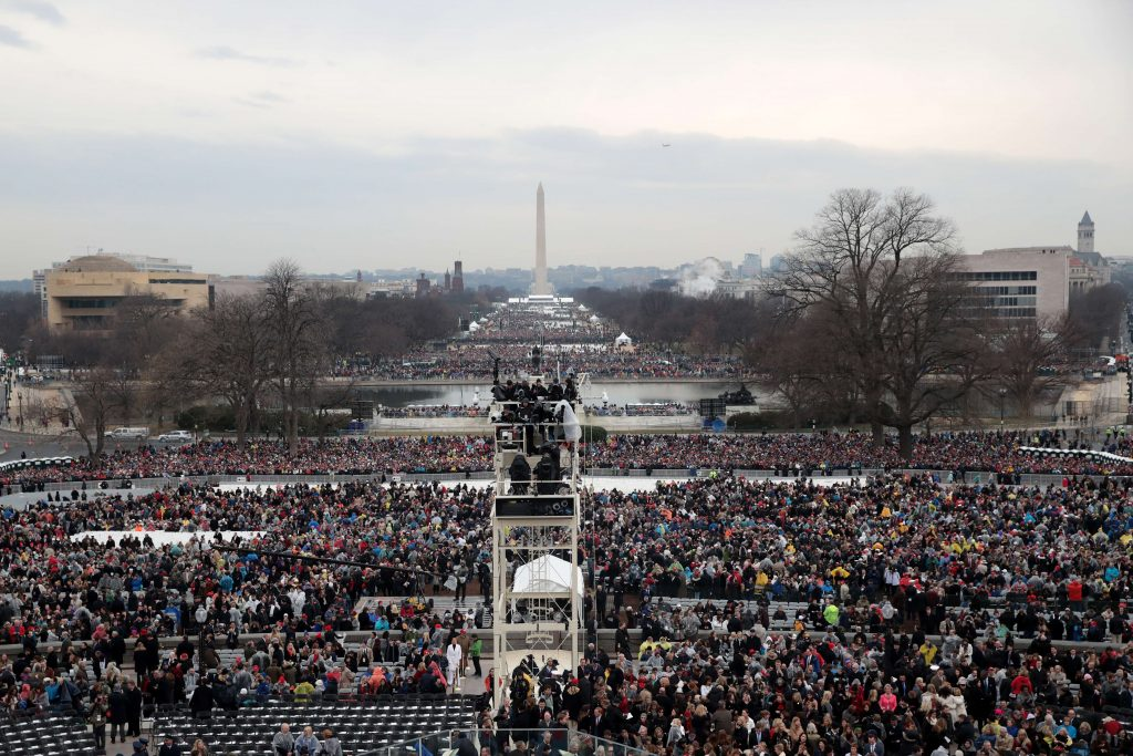 WASHINGTON, DC - JANUARY 20: Spectators fill the National Mall in front of the U.S. Capitol on January 20, 2017 in Washington, DC. In today's inauguration ceremony Donald J. Trump becomes the 45th president of the United States. Scott Olson/Getty Images/AFP == FOR NEWSPAPERS, INTERNET, TELCOS & TELEVISION USE ONLY ==