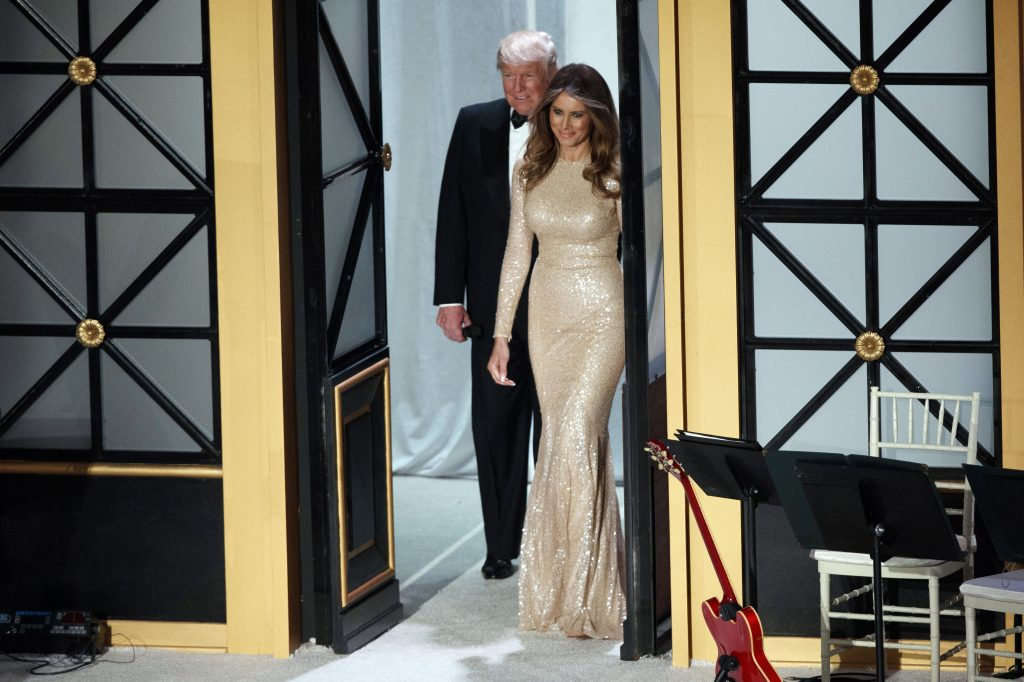 President-elect Donald Trump and his wife Melania arrive to a VIP reception and dinner with donors, Thursday, Jan. 19, 2017, in Washington. (AP Photo/Evan Vucci)