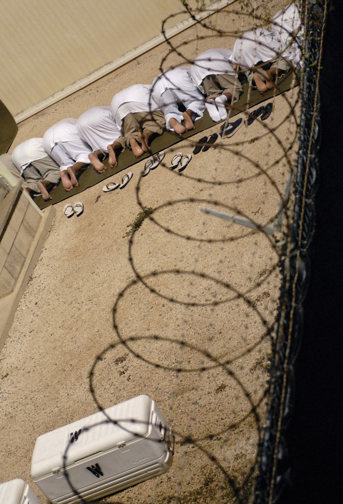 A group of detainees observe morning prayer before sunrise inside Camp Delta at Guantanamo Bay naval base in an October 28, 2009 file photo provided by the US Department of Defense. President Barack Obama urged lawmakers on Tuesday to give his plan to close the U.S. military prison at Guantanamo Bay, Cuba, a