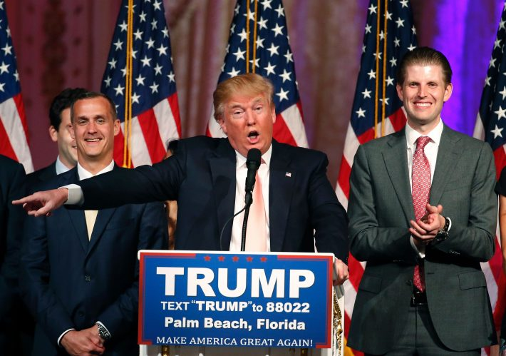 CORRECTION - Republican presidential candidate Donald Trump (C) with his son, Eric (R), addresses the media following victory in the Florida state primary on March 15, 2016 in West Palm Beach, Florida. The win in Florida for Trump sent rival Marco Rubio, the US senator from the Sunshine State, crashing out of the campaign. The 69-year-old billionaire also won in Illinois and North Carolina. / AFP PHOTO / RHONA WISE / ?The erroneous mentions appearing in the metadata of these photos by RHONA WISE has been modified in AFP systems in the following manner: [Republican presidential candidate Donald Trump (C) with his son, Eric (R),] instead of [Republican presidential candidate Donald Trump (C) with his son Donald Trump Jr (R)]. Please immediately remove the erroneous mentions from all your online services and delete them from your servers. If you have been authorized by AFP to distribute them to third parties, please ensure that the same actions are carried out by them. Failure to promptly comply with these instructions will entail liability on your part for any continued or post notification usage. Therefore we thank you very much for all your attention and prompt action. We are sorry for the inconvenience this notification may cause and remain at your disposal for any further information you may require.?
