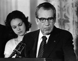 FILE -- President Richard M. Nixon says an emotional goodbye to his Cabinet and staff at the White House on Aug. 9, 1974. At left is his daughter, Julie Nixon Eisenhower. Nixon was driven from office by the Watergate scandal, resigning in the face of certain impeachment. (Mike Lien/The New York Times)