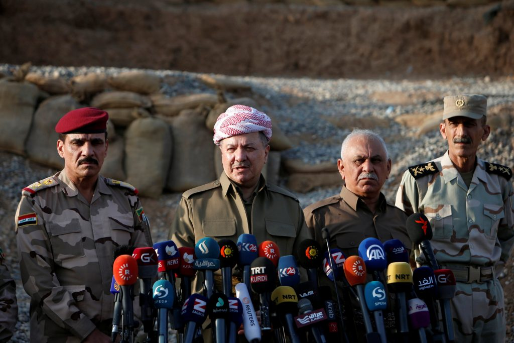 Iraq's Kurdistan region's President Massoud Barzani (C) speaks during a news conference on the outskirts of Mosul, Iraq, October 17, 2016. REUTERS/Azad Lashkari