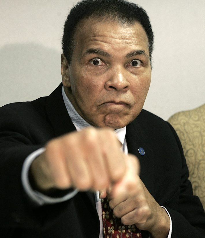 FILE - This is an Oct. 4, 2006, file photo showing Muhammad Ali posed in Detroit. The Muhammad Ali Center in Kentucky says it's planning a four-day celebration early next year to coincide with what would have been the boxing great's 75th birthday. The community activities at the downtown center in Ali's hometown of Louisville will start Jan. 14 and continue through Ali's birthday on Jan. 17. (AP Photo/Paul Sancya, File)