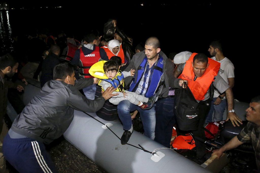 Syrian refugees arrive at the coast of the southeastern island of Kos, Greece, after reaching the country by its sea borders with Turkey, May 8, 2015. The refugees were spotted by the Greek Coast Guard during a night rescue operation and led to the shore in safety where they were later detained by the Greek authorities. REUTERS/Giorgos Moutafis TPX IMAGES OF THE DAY
