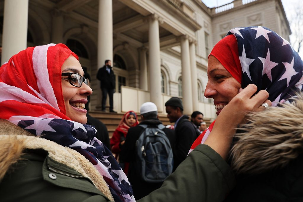 NEW YORK, NY - FEBRUARY 01: New York City Police Officers Aml Elsokary (left) and Maritza Morales wear American Flag head scarfs at an event at City Hall for World Hijab Day on February 1, 2017 in New York City. The day was started five years ago when a Muslim in New York invited other women to experience what it is like to wear a hijab every day in America. The day is now celebrated in cities around the world. Spencer Platt/Getty Images/AFP == FOR NEWSPAPERS, INTERNET, TELCOS & TELEVISION USE ONLY ==