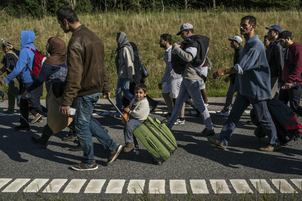 FILE -- Refugees march along the E45 highway toward Sweden near the village of Kliplev, Denmark, Sept. 9, 2015. President Donald Trump escalated his attack on Sweden's migration policies, doubling down on his suggestion — based on a Fox News report — that refugees in the Scandinavian country were behind a surge in crime and terrorism. (Mauricio Lima/The New York Times)